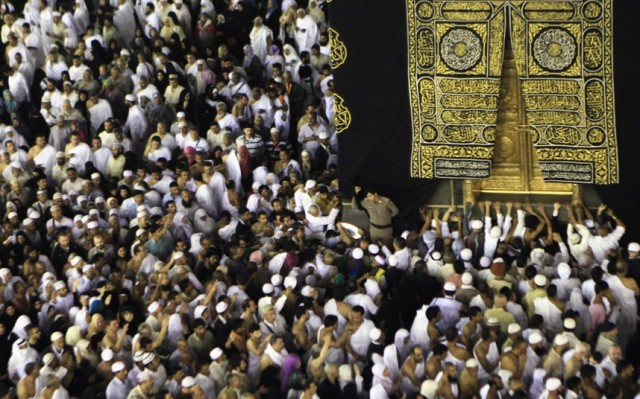 Muslims pray at the door of the Kaaba during their Umrah al-Mawlid an-Nabawi pilgrimage, at the Grand Mosque in the holy city of Mecca. Picture: Amr Abdallah Dalsh/Reuters